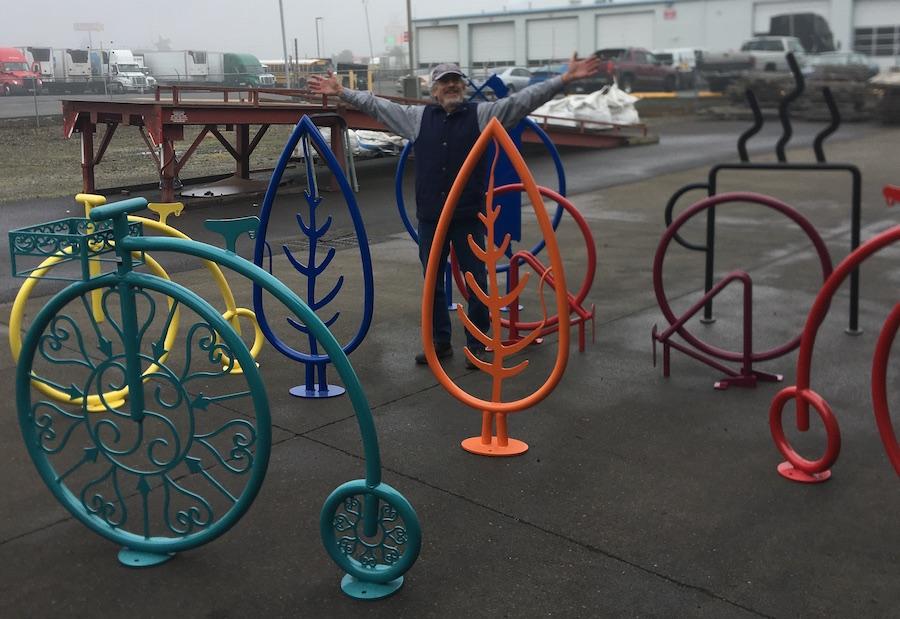 Bike rack maker poses with handiwork